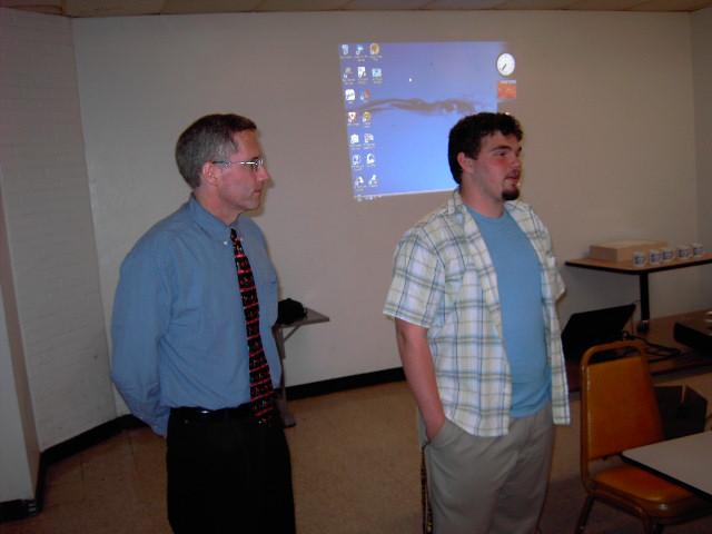 FARA scholarship winner Benjamin Bradley (right), and Richard Walcek, head of Framingham High School's guidance department