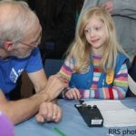 Stan Pozerski, KD1LE with a young participant at Thinking Day On The Air