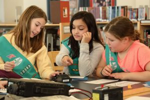 Girl scouts practicing Morse code