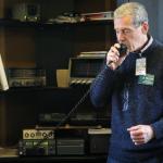 photo of Eric Falkof, K1NUN operating a radio at the Zola Center
