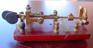 red semi-automatic telegraph key (bug)