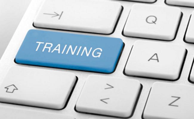"""photo of keyboard with key marked """"training"""""""
