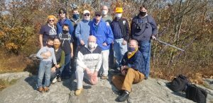 STARS and WARS members posed atop Wachusett Mountain for Summits On The Air